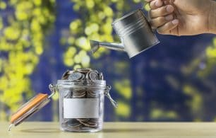 watering can and coins