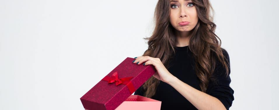 Disappointed woman opening present