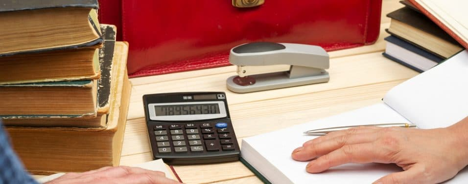 Red briefcase and calculator