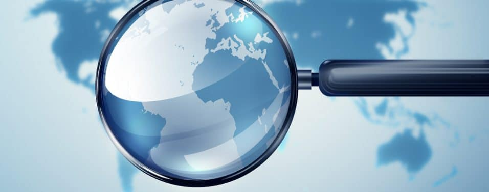 Magnifying glass over the world