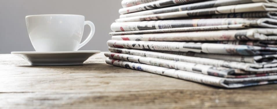 Newspapers and coffee