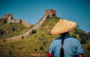 woman facing great wall of china