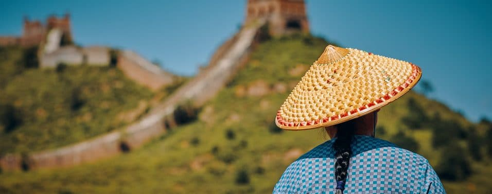 woman facing great wall of china