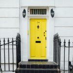 yellow door with whitewashed building