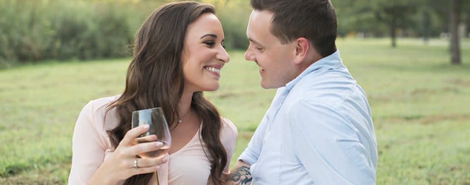 Couple smiling drinking wine