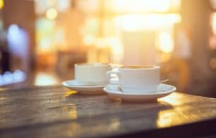 coffee on table with sunset