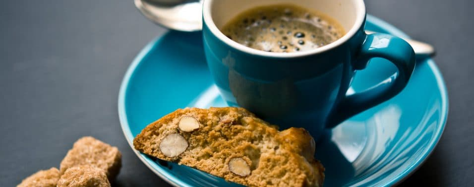 Close up of coffee with biscuit