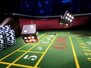 dices throw on craps table at casino