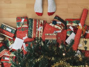 feet by presents christmas tree