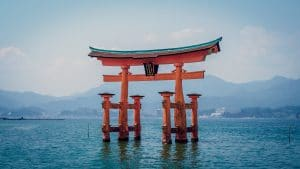 Red shrine in body of water