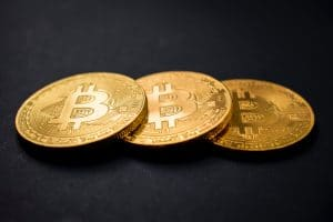 Three bitcoin on black background