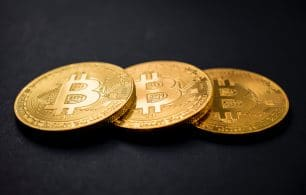 Three bitcoin on black background