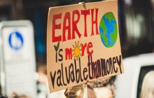 earth more valuable than money sign